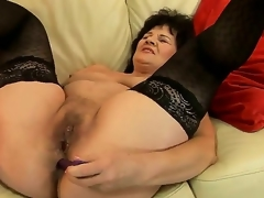 Lovely granny Helena May is getting her cunt and anal tunnel satisfied with sex toys simultaneously