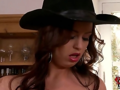 Sirale returns to our site to bedazzle our brains and boners with her jugs. This time the bosomy Czech is in a black costume and a cowboy hat as this playgirl looks on a dining room shelf.