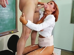 Attractive redhead teacher Vronica Avluv with large wet zeppelins and round bouncing bums in high heels and white shirt seduces rebellious student Preston Parker and rides on his cock.