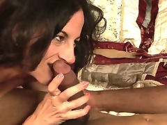 Lusty turned on dark brown milf Melissa Monet with natural hanging meatballs gives head to impure dark fellow and rides on his schlong in bedroom whilst her hubby is at work.