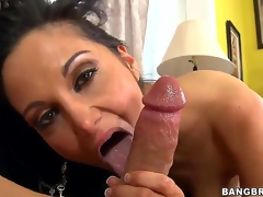 Black haired and arousing milf Ava Addams with big tits gives an astounding blowjob session on the couch after shes done playing with her big dark dildo sex toy int he room.