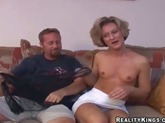 Hawt slim mature brunette milf with miniature tits and fit body in short white skirt and undies has pleasure with her filthy neighbour and takes on his powerful ramrod in living room