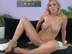Tanya Tate is one perfect bodied milf babe with massive wobblers and bubble ass. She pulls off her belt panties and then gievs a closeup view of her hairless pussy. This hawt buxom milf shows it all