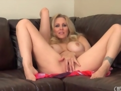 Milf Julia Ann strips in nature's garb and sensually masturbates