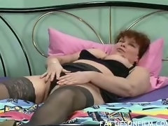 Barbara was just getting willing for bed but stripping her raiment off and seeing her sexy darksome stockings truly made her horny. She then begins massaging her juicy jugs and finger fucking her unshaved box to orgasm.